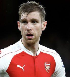 Per Mertesacker picture wearing Arsenal kit.